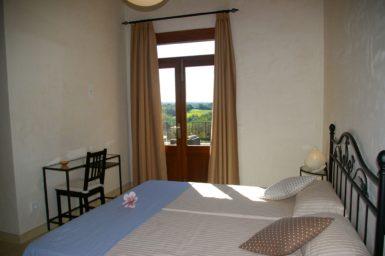 Schlafzimmer mit Zugang auf die Terrasse