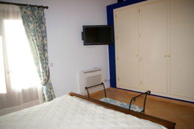 Villa Colom - Schlafzimmer mit Sat-TV